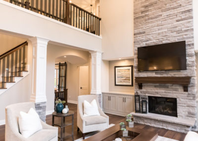Get the look of this inviting den with dark Hardwood Vendor floors, gray Stone Vendor stones from floor to ceiling and custom Cabinet Vendor Cabinets.